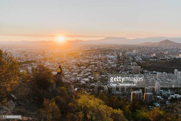 woman in santiago at sunset - santiago chile stock pictures, royalty-free photos & images