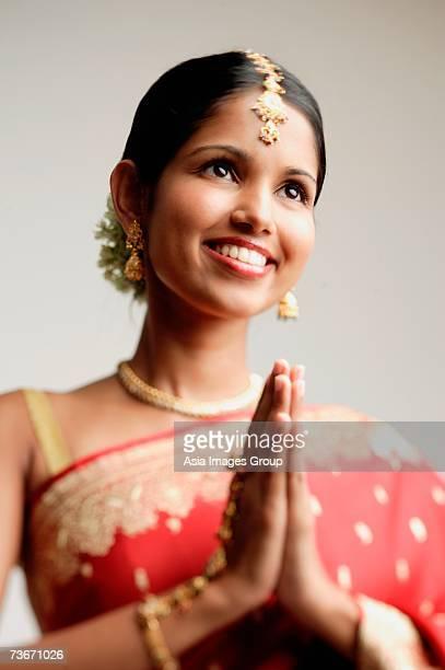 woman in sari, hands together - prayer pose greeting bildbanksfoton och bilder