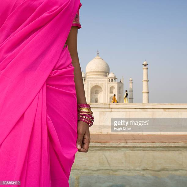 woman in sari standing near taj mahal - hugh sitton stock pictures, royalty-free photos & images