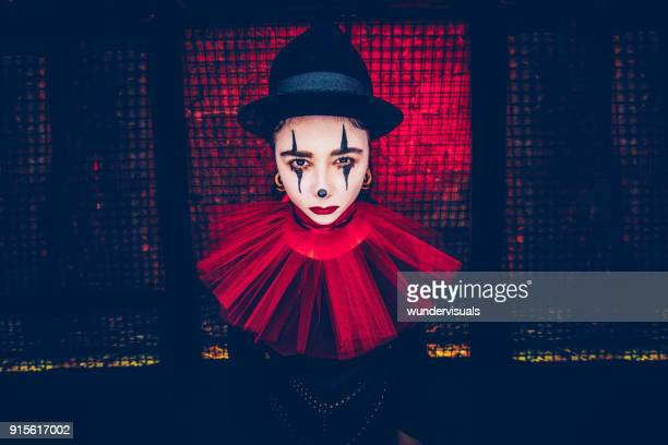woman in scary clown costume at halloween party - scary clown makeup stock photos and pictures