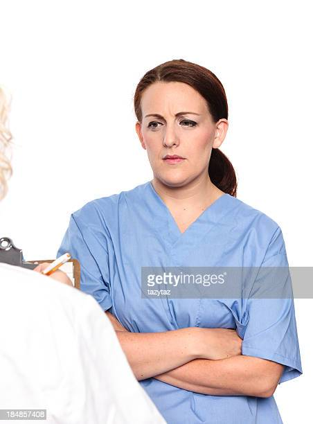 Woman in Scrubs shows concern