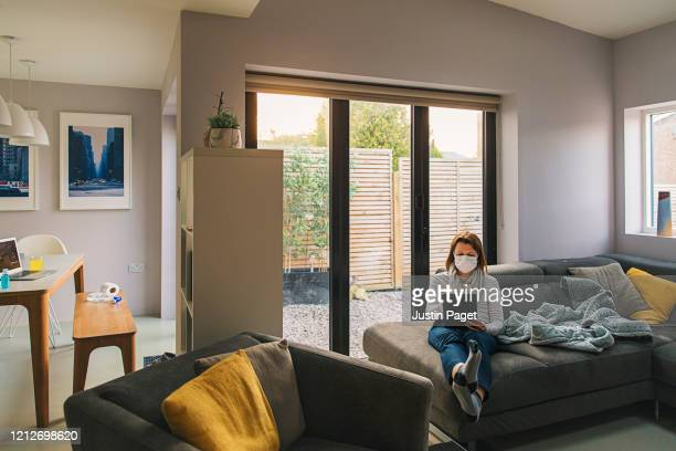woman in self isolation at home - sliding door stock pictures, royalty-free photos & images