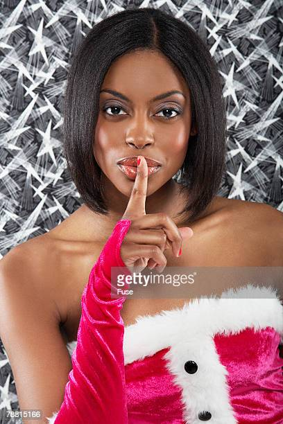 Woman in Sexy Elf Costume with Finger on Lips