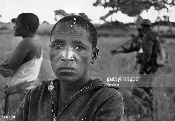 A woman in shock having witnessed the murder of South West African People's Organisation troops by UNITA forces during an Angolan Civil War