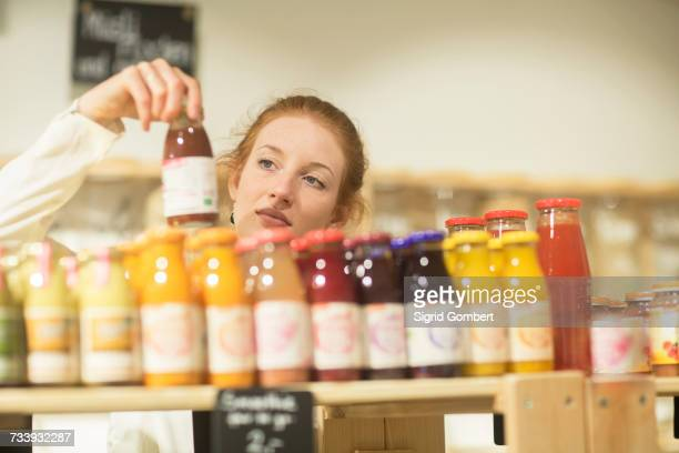 Woman in shop looking at smoothies
