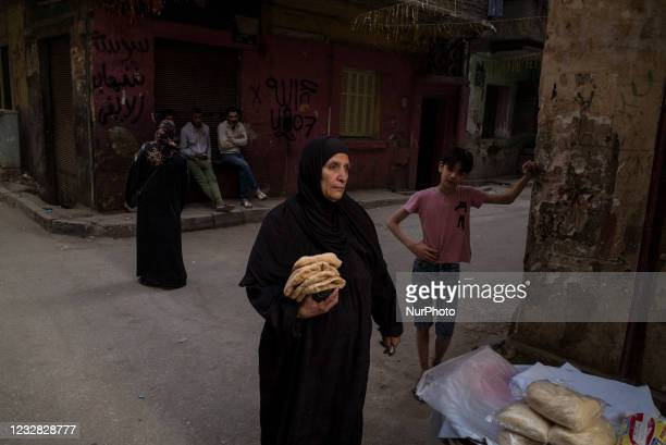 Woman in Shoubra is buying bread for the first meal of the fasting day in Ramadan on April 16 Cairo , Egypt