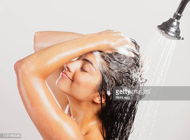 woman in shower - shampoo stockfoto's en -beelden