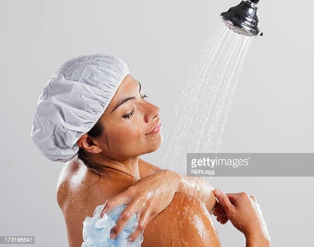 woman in shower - loofah stock photos and pictures