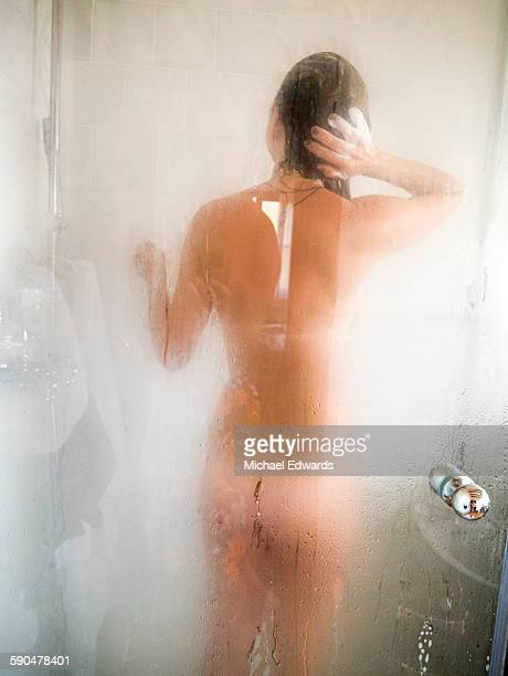 woman in shower - bare bottom women stock photos and pictures