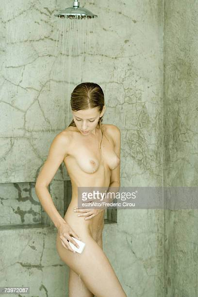 Woman in shower, washing leg