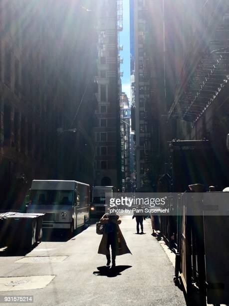 Woman in Silhouette Walking Through Downtown Chicago Alley on Blustery Winter's Day