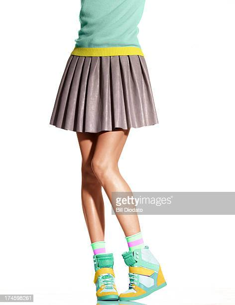 woman in skirt and wedge sneakers - women wearing short skirts stock pictures, royalty-free photos & images