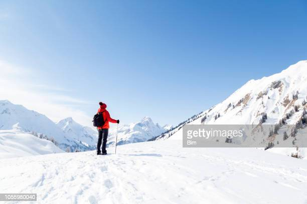 Woman in Snow Covered Mountains