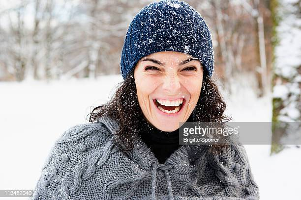 Woman in snow laughing