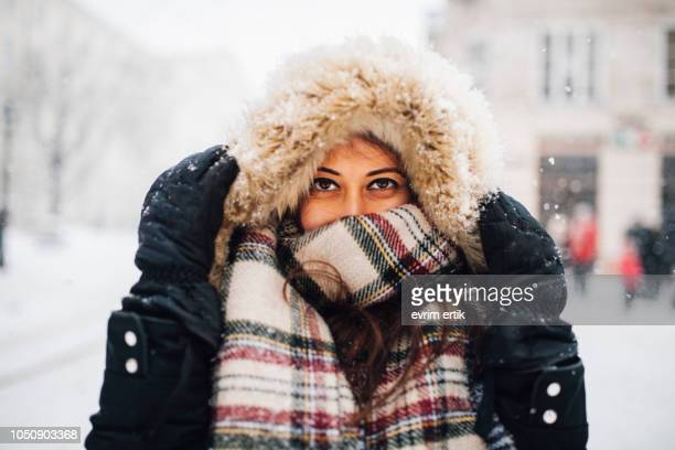 woman in snowy winter - scarf stock pictures, royalty-free photos & images