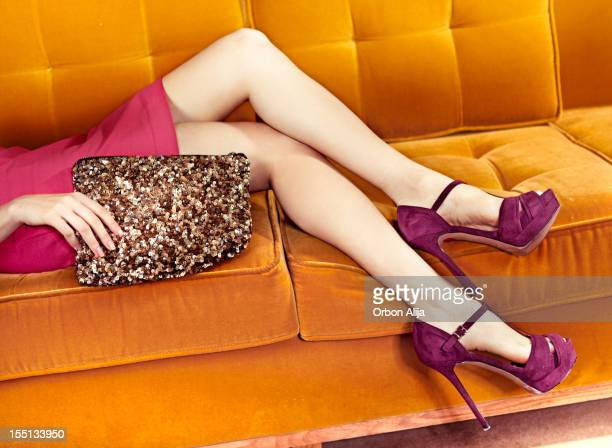 woman in sofa - purple shoe stock pictures, royalty-free photos & images
