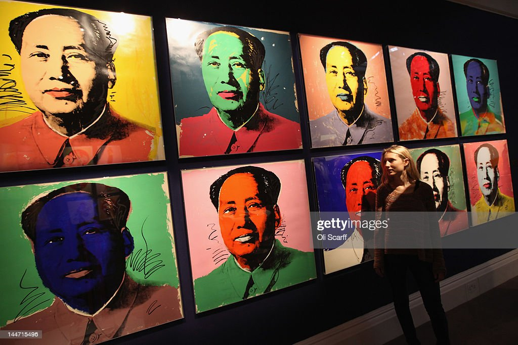 A woman in Sotheby's auction house views an artwork by Andy Warhol entitled 'Chairman Mao' on May 18, 2012 in London, England. The artwork features in Sotheby's forthcoming sale from the collection of Gunter Sachs which is to be held on May 22 and 23, 2012 in London. The collection of over 300 works owned by the late husband of Brigitte Bardot is expected to fetch in excess of 20 million GBP.