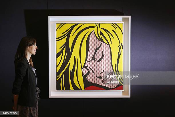 A woman in Sotheby's auction house views 'Sleeping Girl' by Roy Lichtenstein which is expected to fetch in excess of 25 million GBP on April 12 2012...