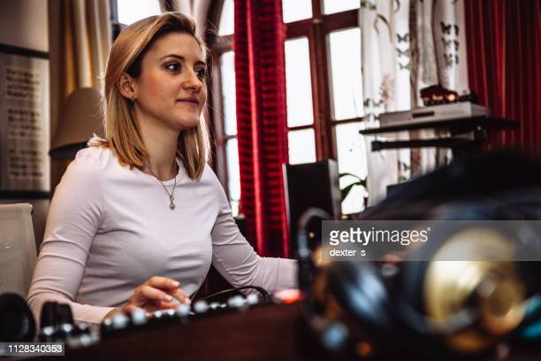 woman in sound recording studio mixer desk - producer stock pictures, royalty-free photos & images