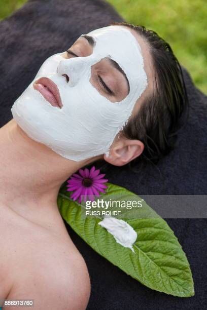 Woman in spa environment, wearing face mask