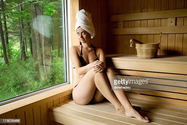 Woman in spa sauna.