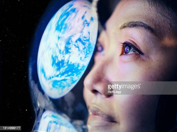 woman in space with earth reflection - global stock pictures, royalty-free photos & images