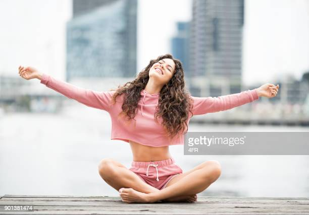 Woman in Sport Outfit enjoying life, Outdoor Meditation, Lifestyle