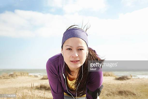 Woman in sports clothes by the sea