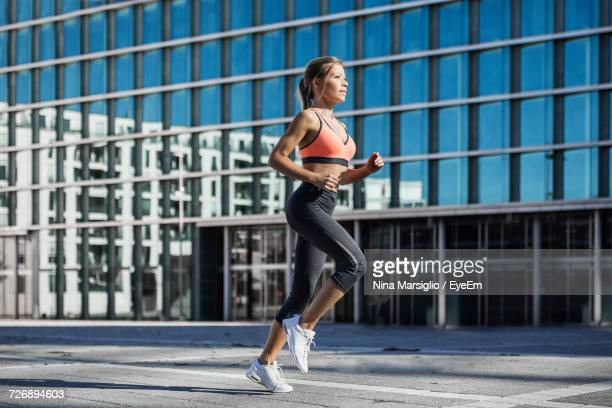 Woman In Sports Clothing Running In City