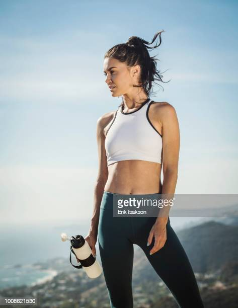 woman in sportswear with water bottle - sports clothing stock pictures, royalty-free photos & images
