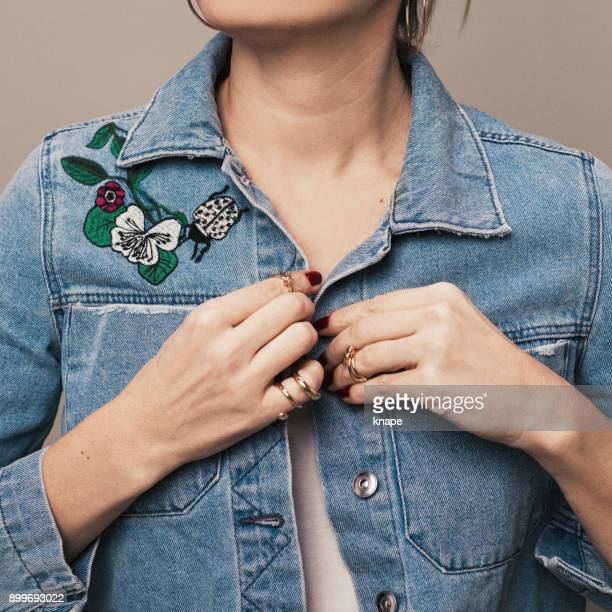 Woman in spring summer fashionable denim jacket with embroidery