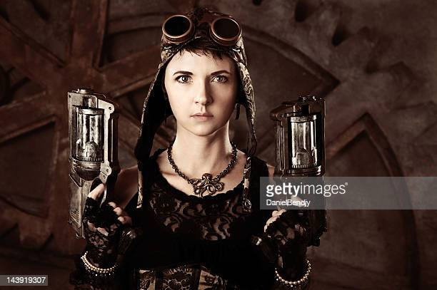 Woman in Steampunk Fashion With Guns