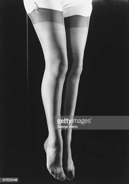 woman in stockings jumping, mid-air, (b&w), low section - stockings no shoes stock photos and pictures