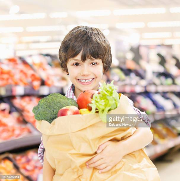 Woman in store carrying shopping bags