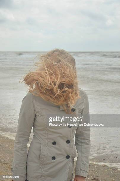 woman in storm on the beach