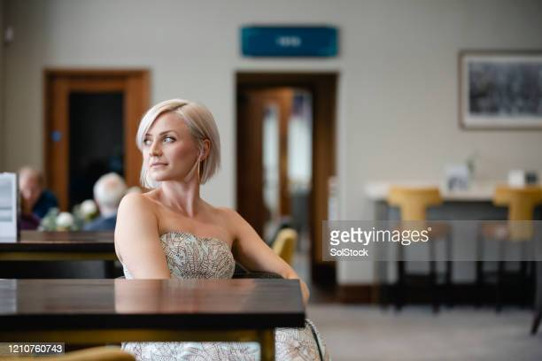 woman in strapless dress looking away from camera - strapless stock pictures, royalty-free photos & images