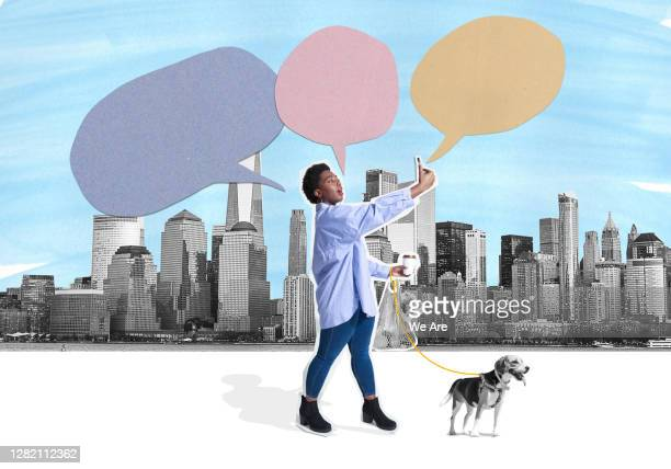 woman in street with mobile phone - playing stock pictures, royalty-free photos & images