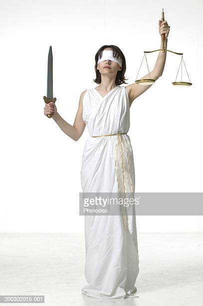 Woman in studio dressed as lady justice
