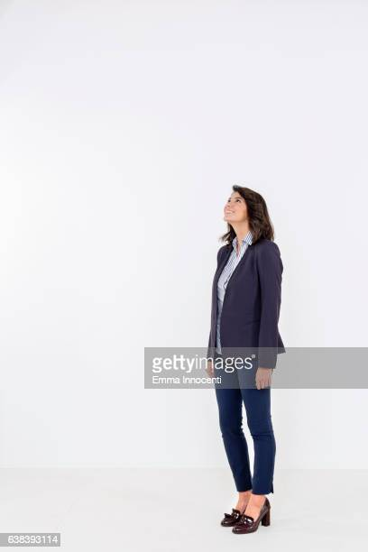woman in suit jacket looking up