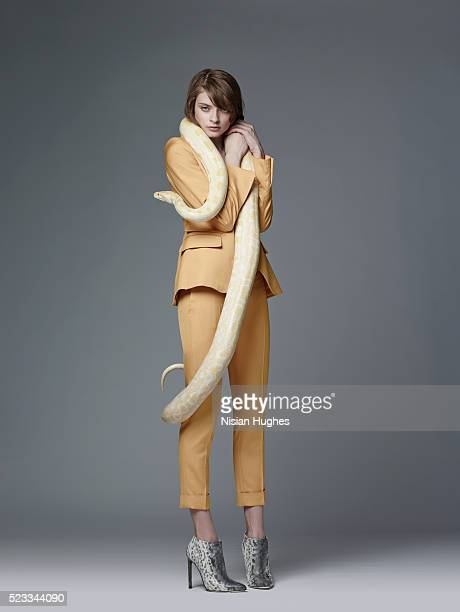 Woman in suit with snake around her neck