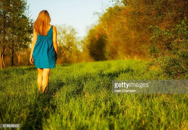 woman in sundress in spring field - grünes kleid stock-fotos und bilder