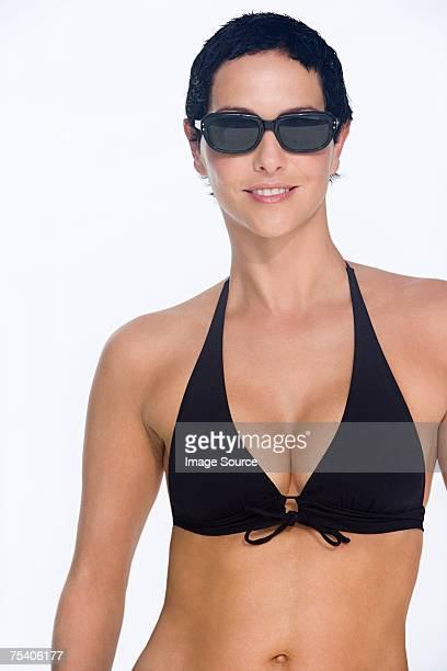 Woman in sunglasses and bikini top