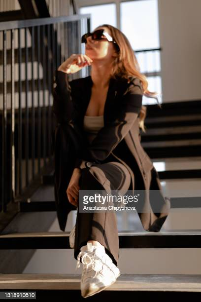 woman in sunglasses - fashion week stock pictures, royalty-free photos & images