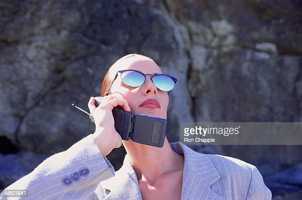 Woman in sunglasses, talking on mobile phone