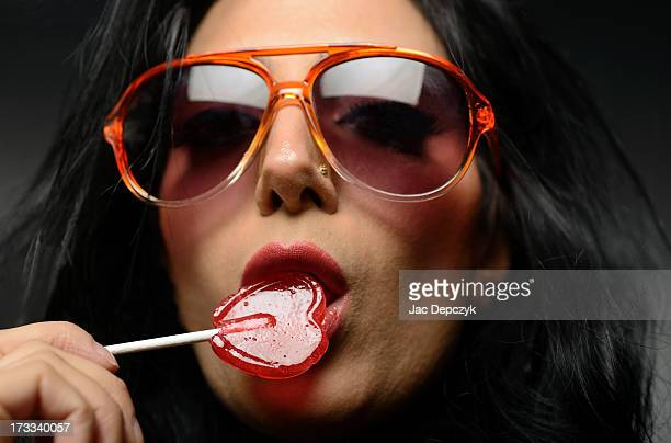 woman in sunglasses with heart-shaped lollipop - depczyk stock pictures, royalty-free photos & images