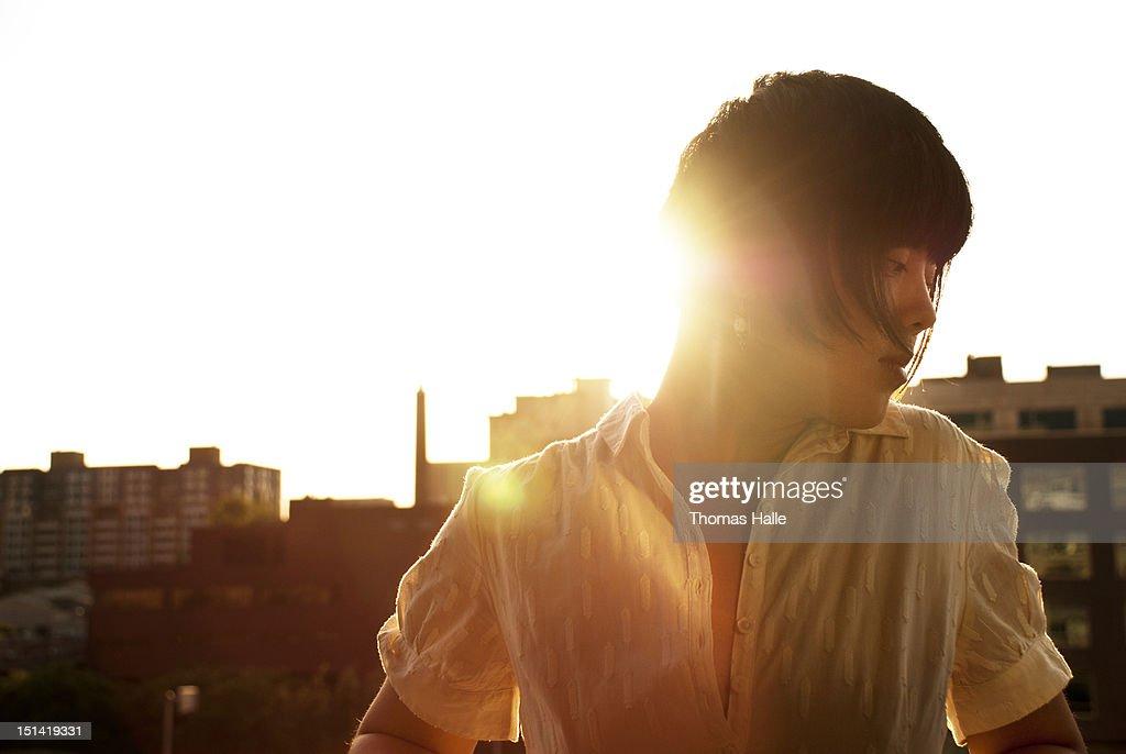 Woman in sunlight : Bildbanksbilder