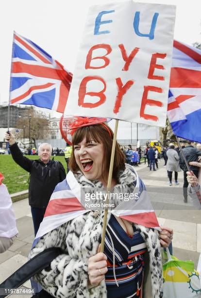 A woman in support of the United Kingdom's exit from the European Union is pictured near the Houses of Parliament in London on Jan 31 as the country...