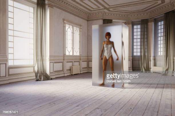 Woman in suspended animation inside room