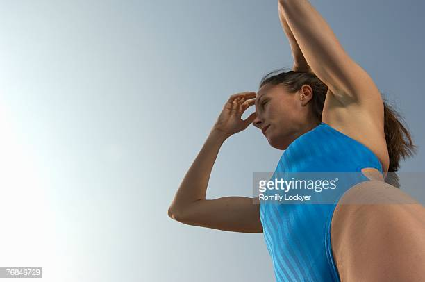 Woman in swimming costume, low angle view