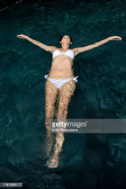 woman in swimming pool - 2010 2019 stock pictures, royalty-free photos & images